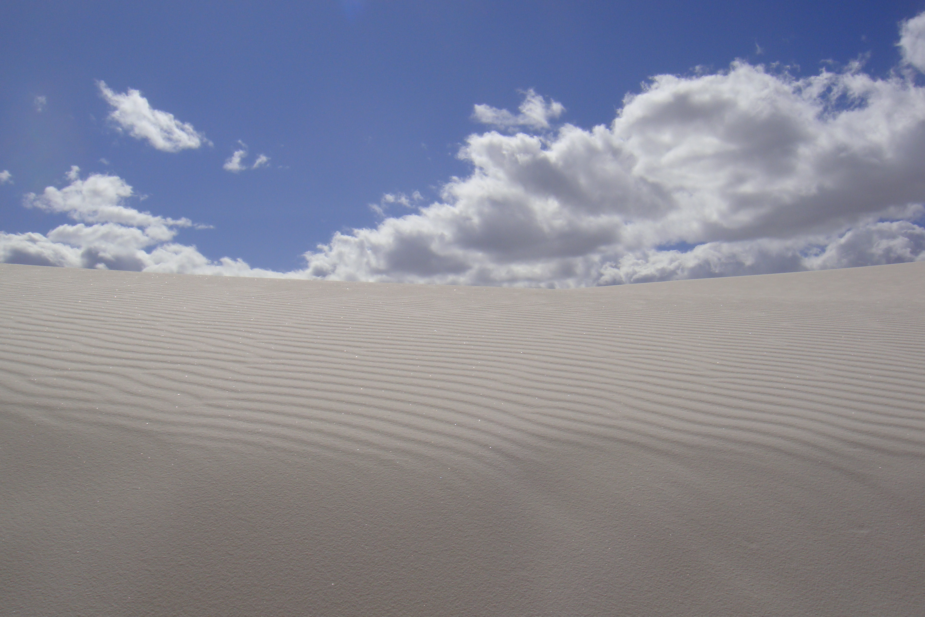 The dune is made of white sand